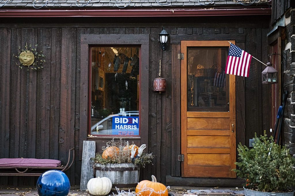 A Biden/Harris sign sits in the window of a home in Aspen still decorated for Halloween on Election Day, Tuesday, Nov. 3, 2020. (Kelsey Brunner/The Aspen Times)