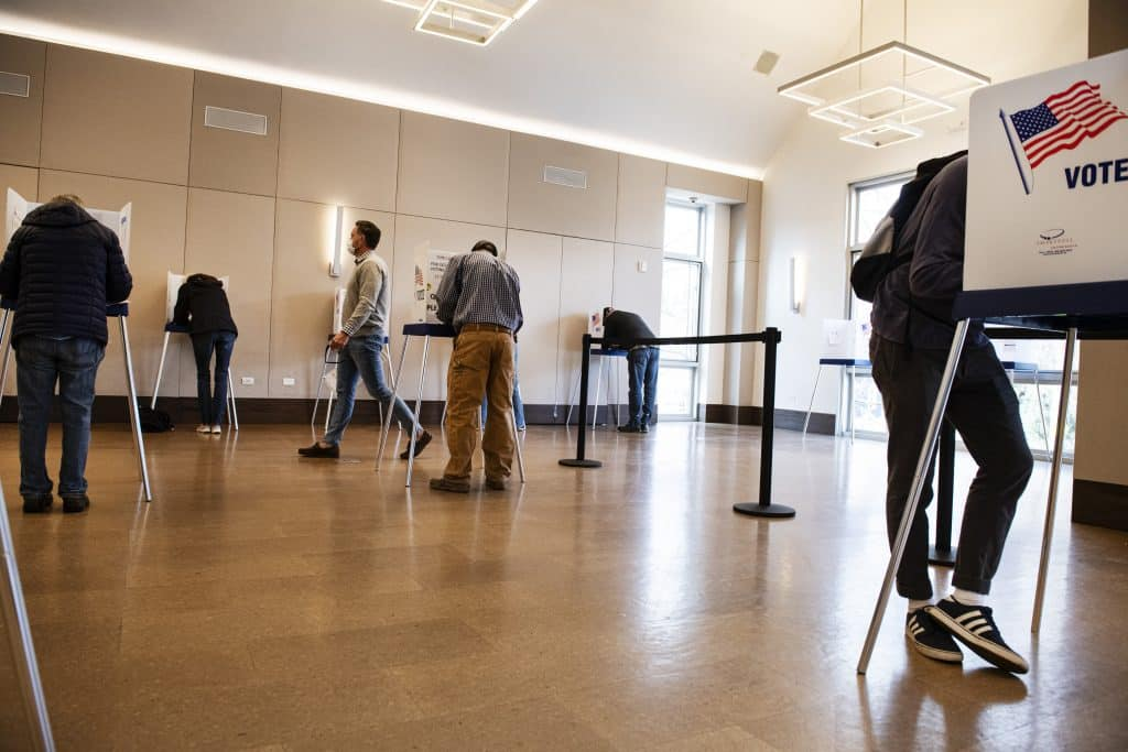 Voters fill out their ballots at socially distanced voting booths in the Aspen Jewish Community Center on Election Day, Tuesday, Nov. 3, 2020.