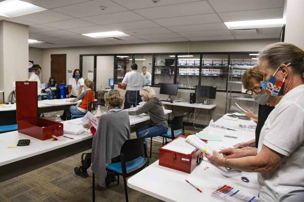 Election officials open and check ballots in the Pitkin County Administration building on Election Day in Aspen on Tuesday, Nov. 3, 2020.
