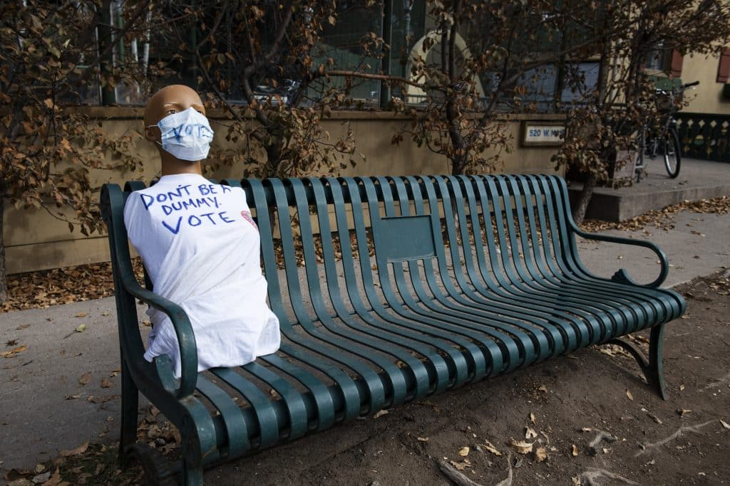 Half a mannequin urges people to vote with a hand drawn t-shirt on a bus stop bench on Election Day in Aspen on Tuesday, Nov. 3, 2020.