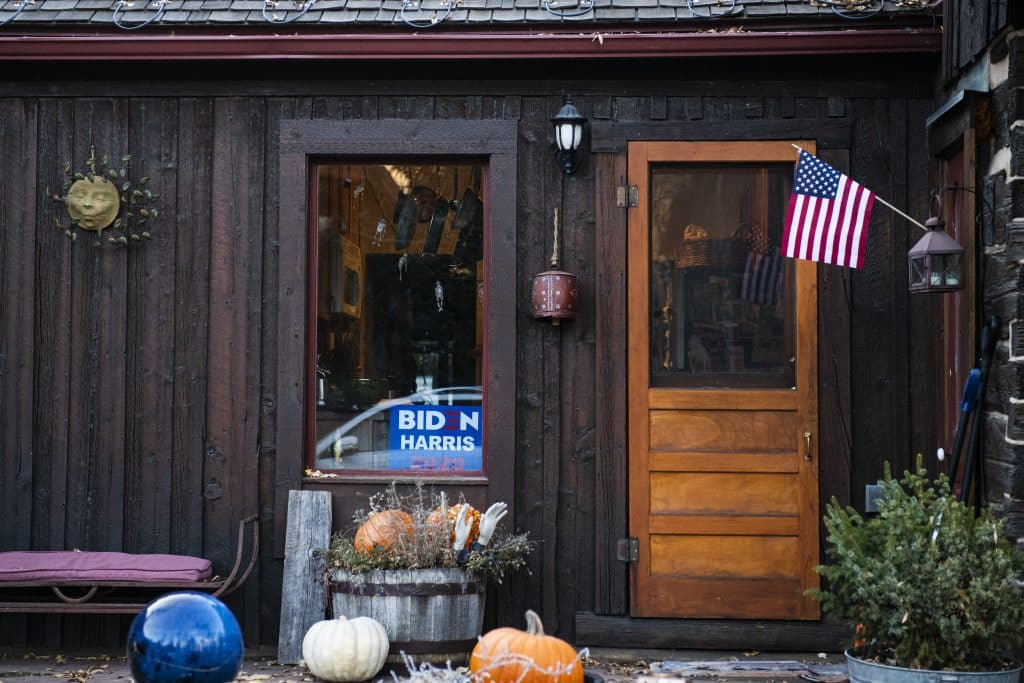 A Biden/Harris sign sits in the window of a home in Aspen still decorated for Halloween on Election Day, Tuesday, Nov. 3, 2020.