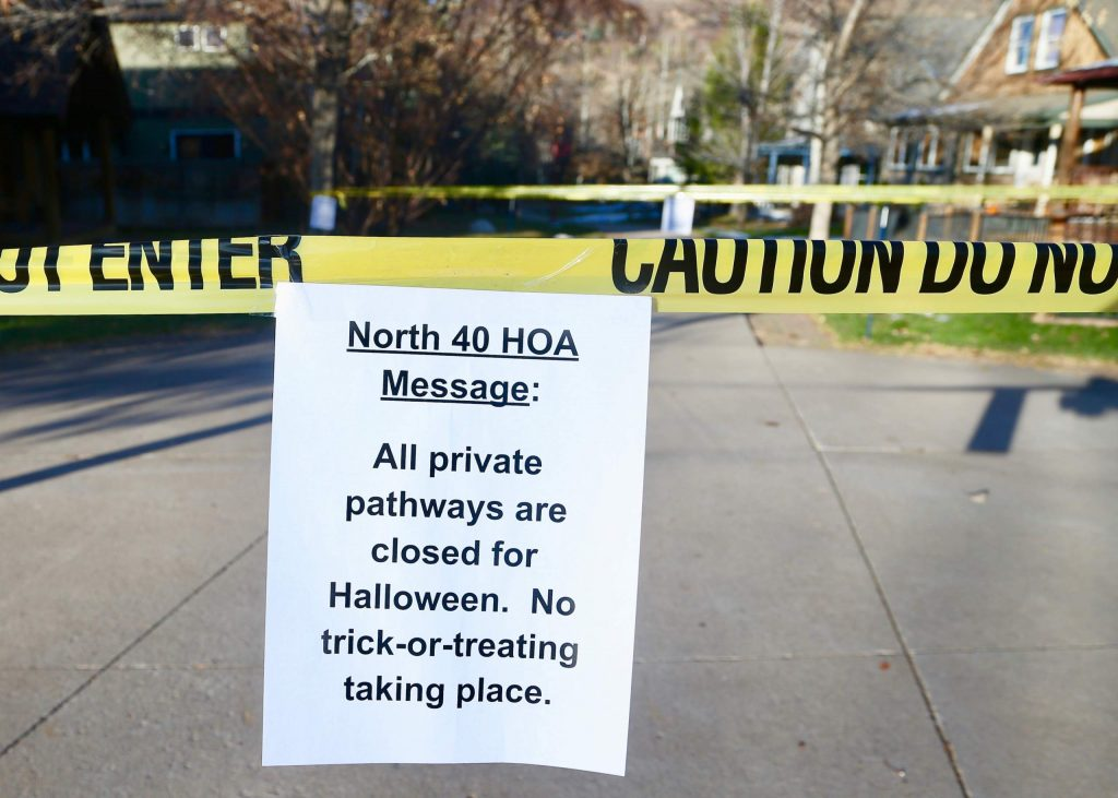 Caution tape and a sign blocks off parts of the North 40 neighborhood to trick-or-treaters on Saturday, Oct. 31, 2020. Normally a mainstay of the neighborhood near the Aspen Business Center, the annual affair was shutdown down by the neighborhood's HOA this year out of precaution due to rising COVID-19 cases around Pitkin County. (Photo by Austin Colbert/The Aspen Times)
