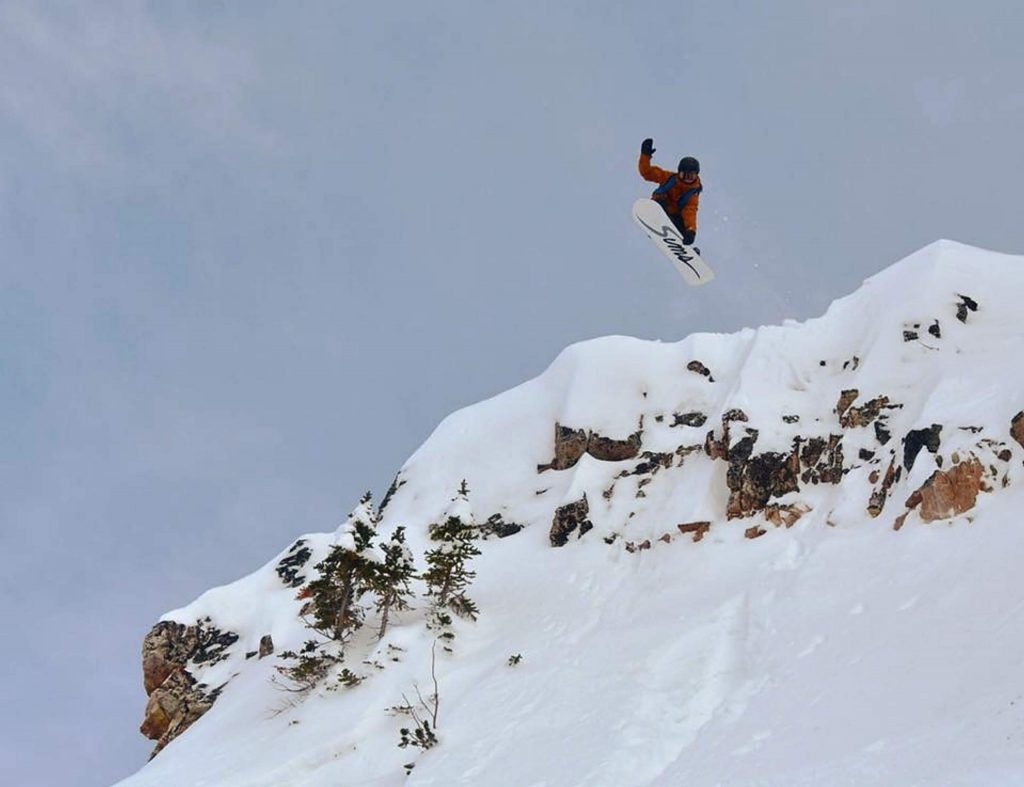 Michael Mawn, who will be making his debut on the Freeride World Tour this season, sends it off of cliff.