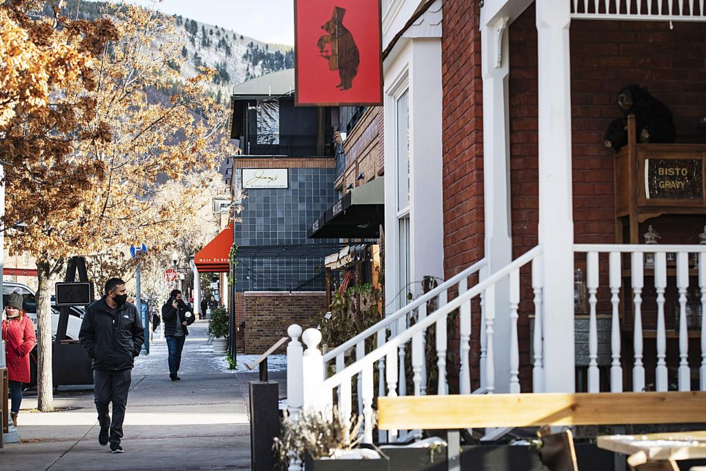 People walk by restaurants in Aspen on Friday, Nov. 13, 2020. (Kelsey Brunner/The Aspen Times)