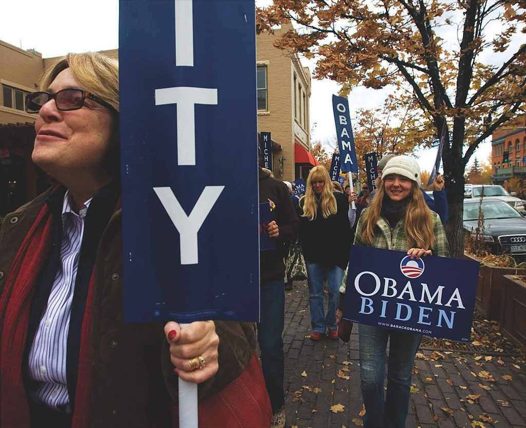 Camilla Auger, left, chairwoman of the Pitkin County Democrats, leads a parade of early voters on Main Street to the Pitkin County Clerk and Recorders Office in 2012.