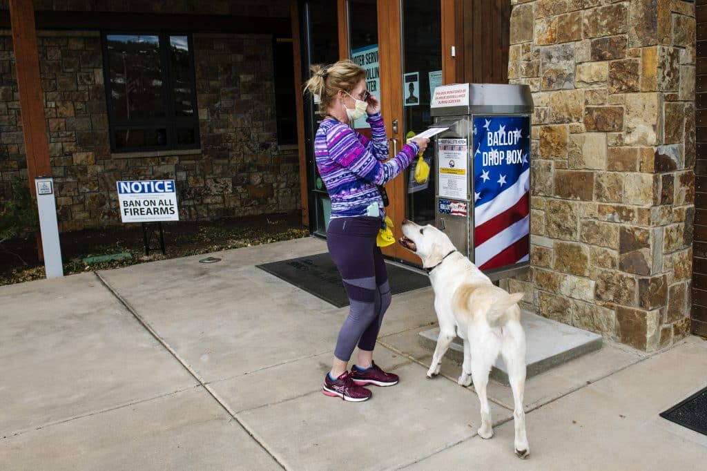 Deb Orzech and her dog Ripley drop off her son's ballot on Election Day in Snowmass on Tuesday, Nov. 3, 2020. Orzech's son lives in New Jersey and she brought his ballot home so he could vote.