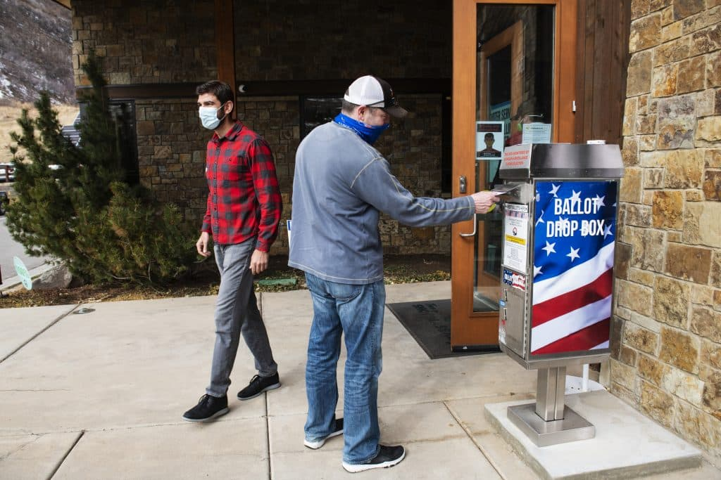 Voters drop their ballots in the drop box outside of Snowmass Town Hall on Election Day, Tuesday, Nov. 3, 2020.