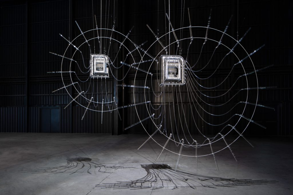 """Installation view of Cerith Wyn Evans' """"the Illuminating Gas,"""" Pirelli Hangar Bicocca, Milan (31 October 2019 – 6 July 2020). © Cerith Wyn Evans. Courtesy of the artist; White Cube and Pirelli Hangar Bicocca. Produced with the technical support of INELCOM, Madrid. Photo: Agostino Osio"""