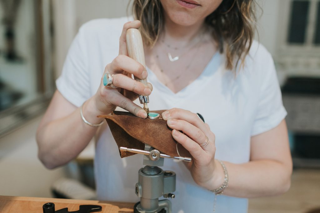 Resident Artist Kate Flynn of Mineral + Mine setting a stone. Kate designs and hand-crafts each piece of jewelry. Photo courtesy of Red Brick Center for the Arts