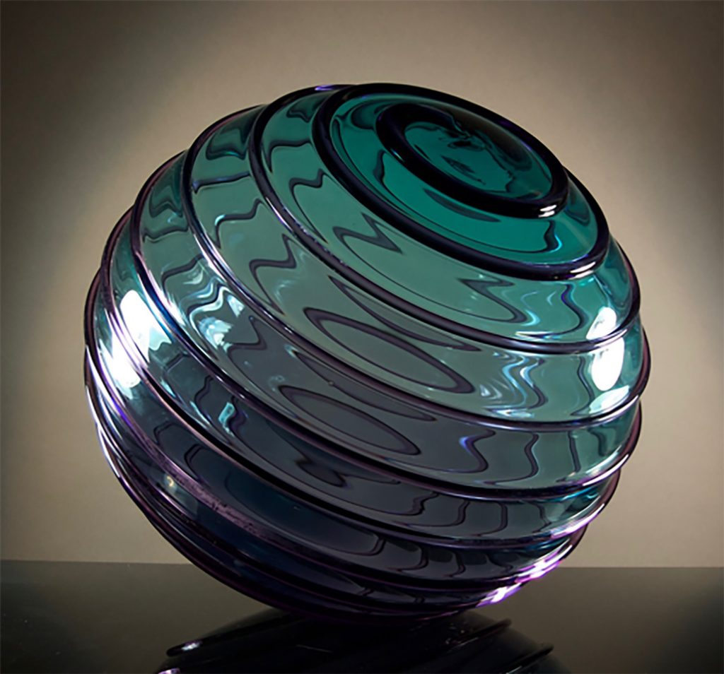 """Rich Royal, """"Teal and Purple Lens"""", Hand blown glass, 19""""h x 18""""w x 18""""d. Photo courtesy of Raven Gallery"""