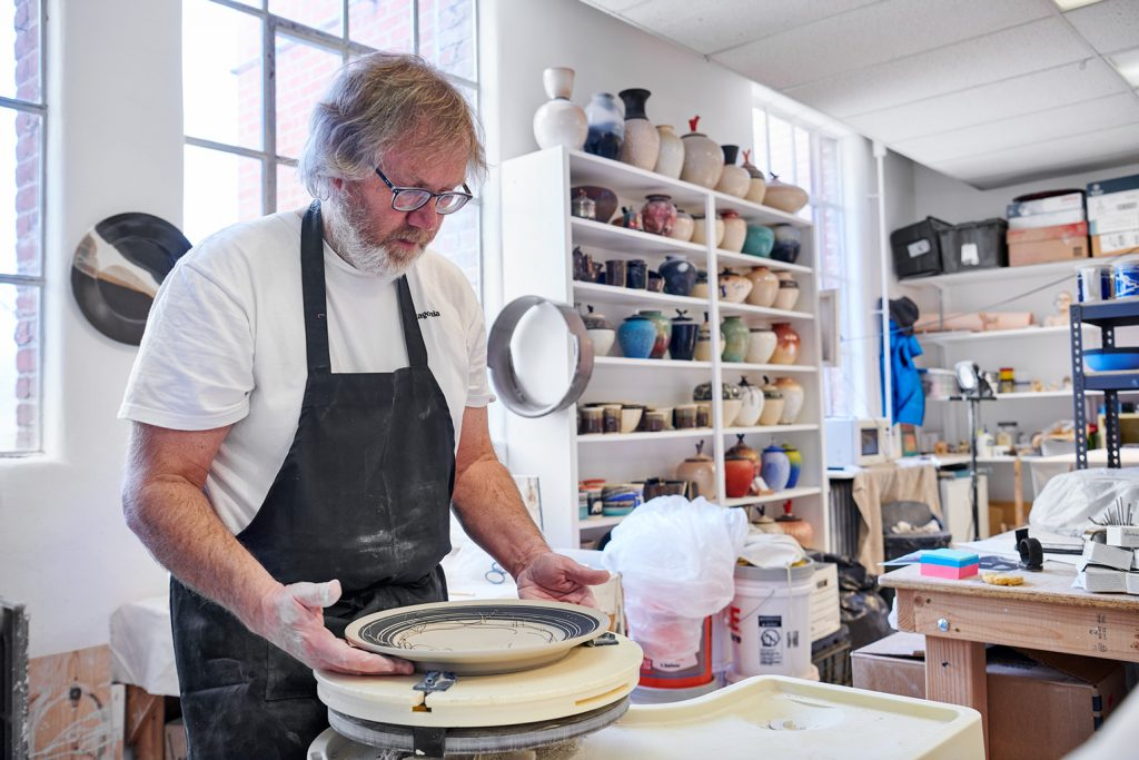 Resident Artist Michael Bonds creates both functional and decorative ceramics pieces and experiments with a variety of firing methods. Photo courtesy of Red Brick Center for the Arts